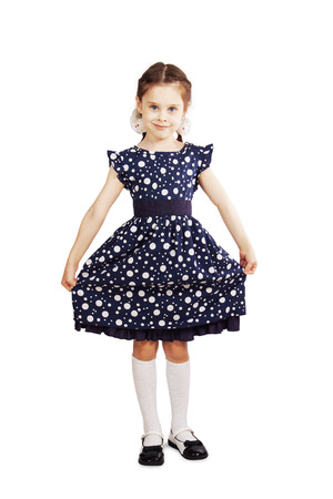kids dress: Pretty young girl wearing the dark blue dress Stock Photo