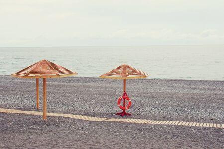 parasols: Wooden parasols on the sea beach