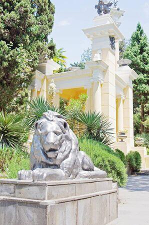 moorish: In the Sochi Arboretum. Sculpture of a lion next to Moorish gazebo Editorial