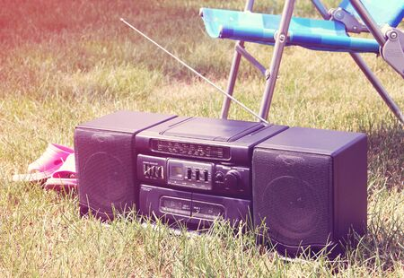 grabadora: Vintage image of an old tape recorder in the garden