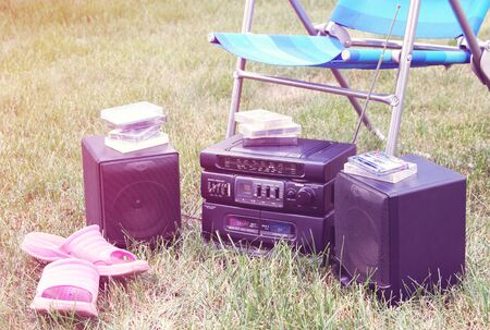 tape recorder: Vintage image of old tape recorder in the garden