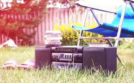 tape recorder: Vintage image with an old tape recorder in the garden Stock Photo