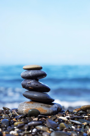 smooth stones: Stack of round smooth stones on the seashore Stock Photo