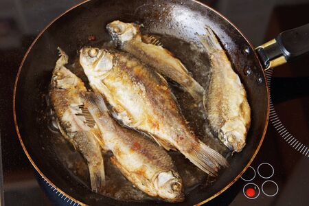 Fresh fish is being fried on the frying pan