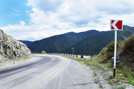 mountaintops: Steep dangerous turn on a mountain road Stock Photo