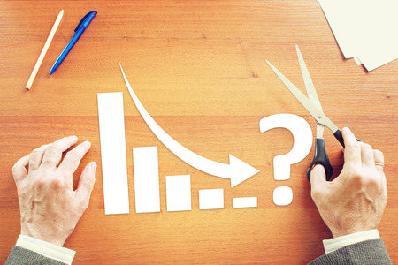 market crash: Chart of Business Decrease  With an Arrow Falling Down. Concept of Crisis With Paper Scrapbooking Stock Photo