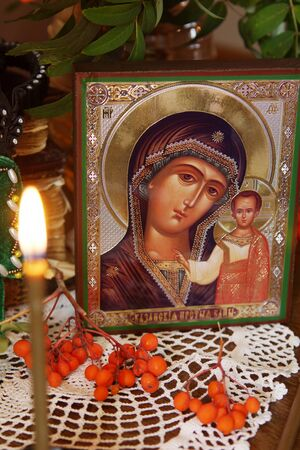 mother mary: Religious orthodox still life with an icon of the Mother Mary and burning candle