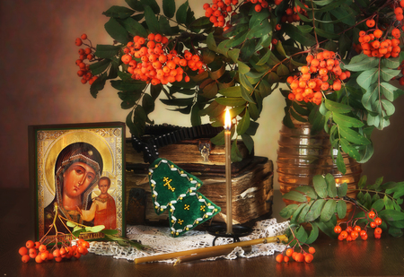 Mother Mary: Religious still life with an icon of the Holy Mother and rowan tree branches Stock Photo