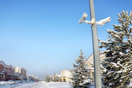 accurately: Outdoor security cameras at the street in a winter town