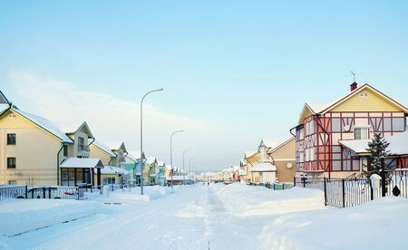 accurately: Street with cottages in the winter village