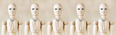 impersonal: Wooden puppets as impersonal office staff stand in a row