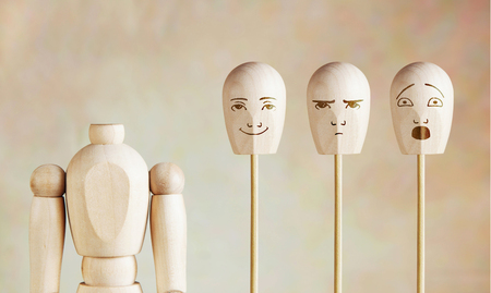 Various human emotions and mood. Abstract image with a wooden puppet