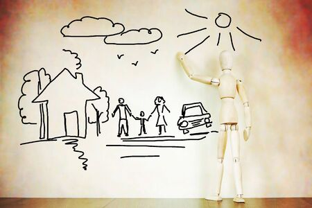 marioneta de madera: Man draws happy traditional family. Abstract image with a wooden puppet Foto de archivo