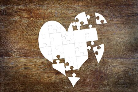 unfortunate: Broken heart as puzzles. Abstract image with paper scrapbooking
