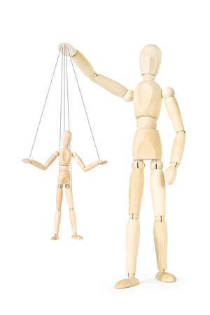 marionette: Man holds in his hands the marionette on threads. Abstract image with a wooden puppet Stock Photo