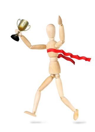 marioneta de madera: Sportsman winner of championship isolated over white background. Abstract image with a wooden puppet Foto de archivo