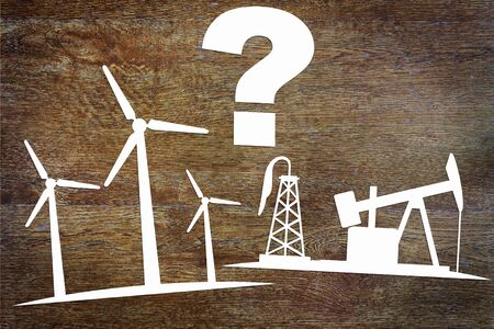 Choices between clean renewable energy and oil production. Abstract image with paper scrapbooking
