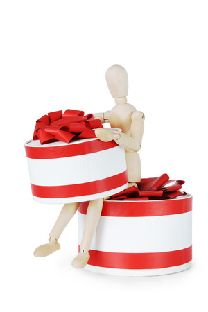 marioneta de madera: Man with two huge round gift boxes. Abstract image with a wooden puppet Foto de archivo