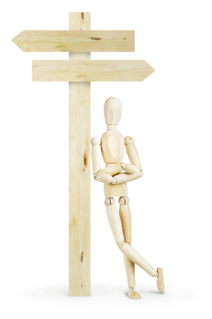 leaned: Man leaned against a wooden signpost. Abstract image with a wooden puppet