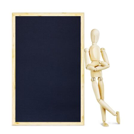 leaned: Man leaned his shoulder against a clean blackboard. Abstract image with a wooden puppet