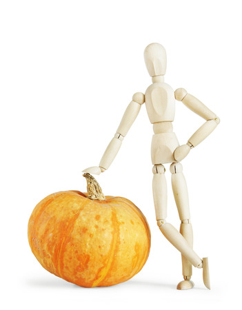 leaned: Man leaned against a giant pumpkin. Abstract image with a wooden puppet Stock Photo