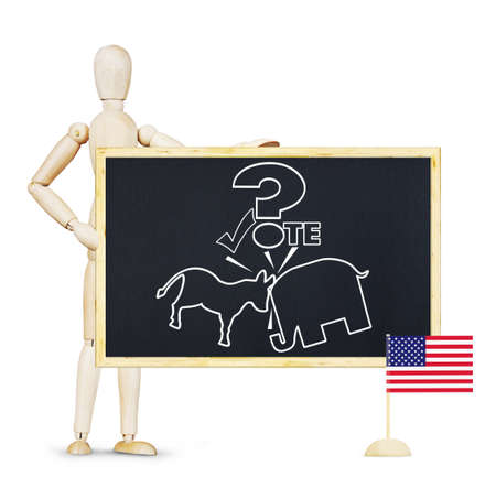 campaigning: Man campaigning to vote on elections in the US. Abstract image with a wooden puppet