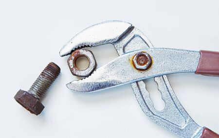 combination: Combination pliers with old rusty nut and bolt Stock Photo