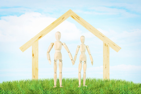 joyous: Joyous couple and a house outdoor. Abstract image with a wooden puppets
