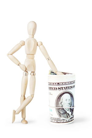 leaned: Man leaned against a big bundle of dollars. Abstract image with a wooden puppet Stock Photo