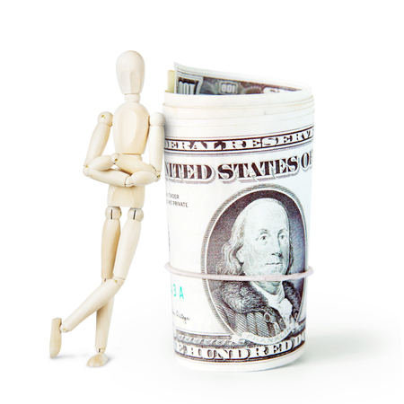 leaned: Man leaned against a huge bundle of dollars. Abstract image with a wooden puppet Stock Photo
