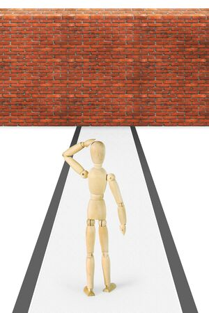 marioneta de madera: Man stands in front of the brick wall. Abstract image with a wooden puppet
