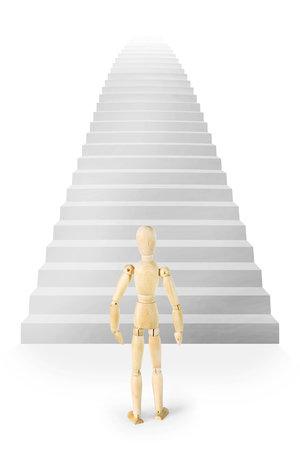 carreer: Man stands in front of a very high stairs ascending up. Abstract image with a wooden puppet