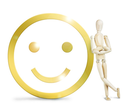 leaned: Man leaned against a huge golden positive smiley. Abstract image with a wooden puppet