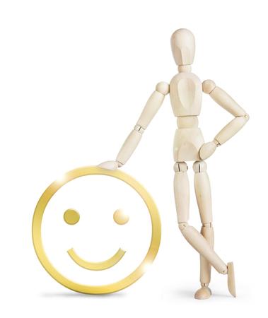 wooden puppet: El hombre se apoy� en un gran sonriente positiva de oro. Imagen abstracta con una marioneta de madera Foto de archivo
