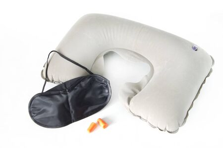 earbuds: Set for travelling. Inflatable neck pillow with eye mask and earbuds