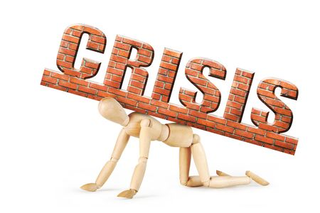 Man stands on his knees under the heavy weight of crisis. Abstract image with a wooden puppet