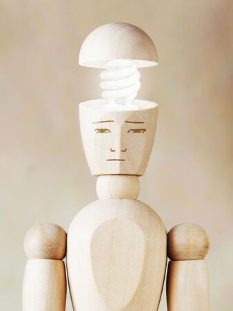 puppet: Glowing light bulb in the human head. Concept of genius. Abstract image with wooden puppet