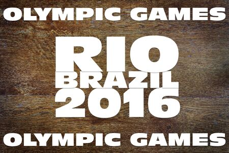 olympic symbol: Olympic Games in Brazil 2016. Abstract conceptual image on wooden background
