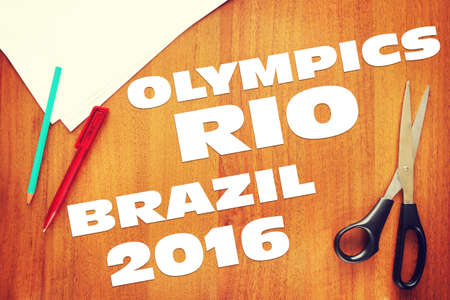 cuttings: Paper cuttings about Olympic Games in Brazil on wooden background. Abstract conceptual image