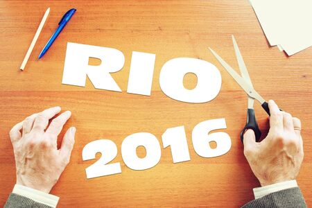 olympic symbol: Man dreams about Olympic Games in the Rio. Abstract conceptual image Editorial