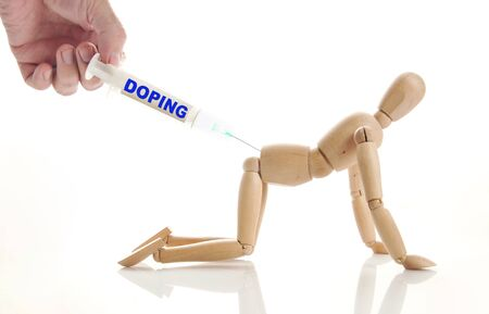 marioneta de madera: Concept of doping use. Abstract image with a wooden puppet