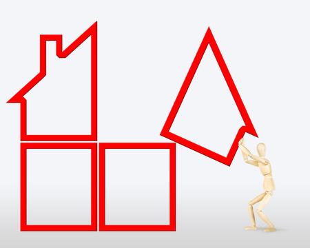 marioneta de madera: El hombre construye una casa. Imagen abstracta con una marioneta de madera Foto de archivo
