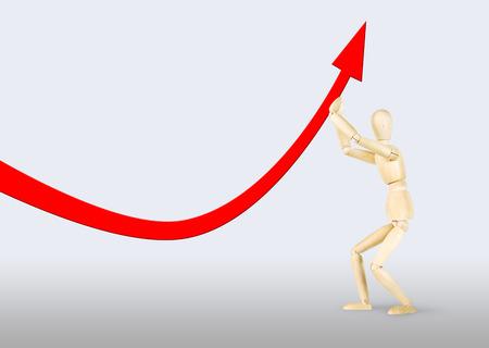 marioneta de madera: El hombre levantando una flecha que cae hacia arriba. Imagen abstracta con una marioneta de madera