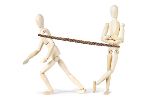 slacker: Man tugs another one to make him move. Abstract image with wooden puppets