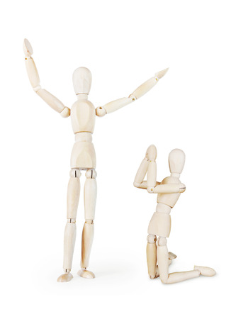 Preacher and a prayer. Abstract image with wooden puppets Stock Photo