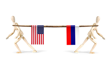 rivalry: Rivalry of Russia and USA. Two men pull a rope in different directions. Abstract image with wooden puppets Stock Photo