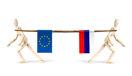 rivalry: Rivalry of Russia and EU. Two men pull a rope in different directions. Abstract image with wooden puppets