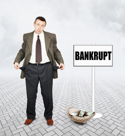 begging: Frustrated businessman begging for alms. Concept of bankruptcy Stock Photo