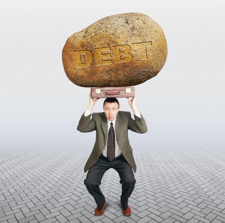 Debtor under the burden of debt. Difficulties in business concept Stock Photo