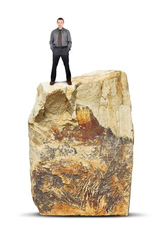huge: Man stands on the top of a huge rock. Isolated over white background